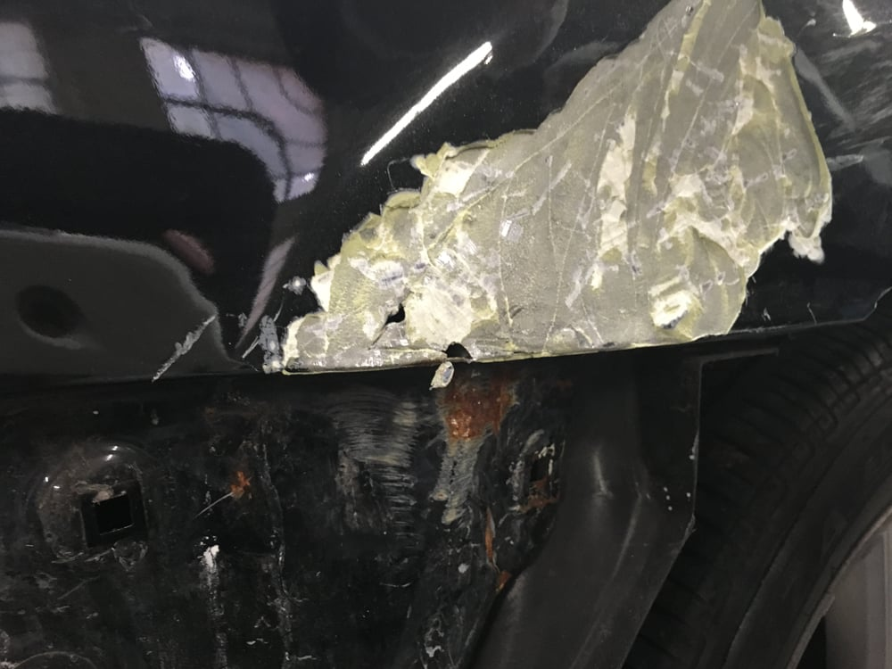 Almost a half inch of bondo on rear quarter panel, and ...