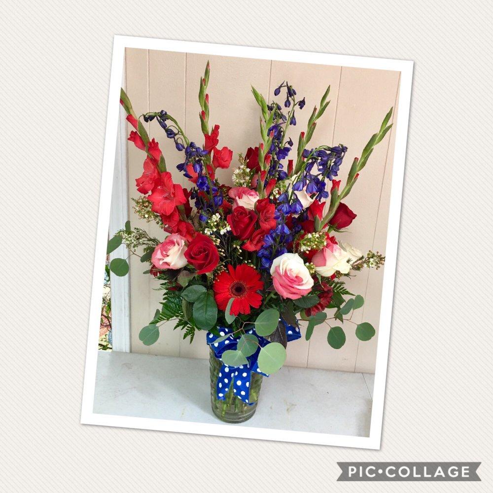 Clarabella Flowers: 1395 N McEwan St, Clare, MI