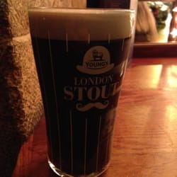 The Bombardier - Paris, France. London Imperial Stout in a baller pinstripe glass.  Perfection.