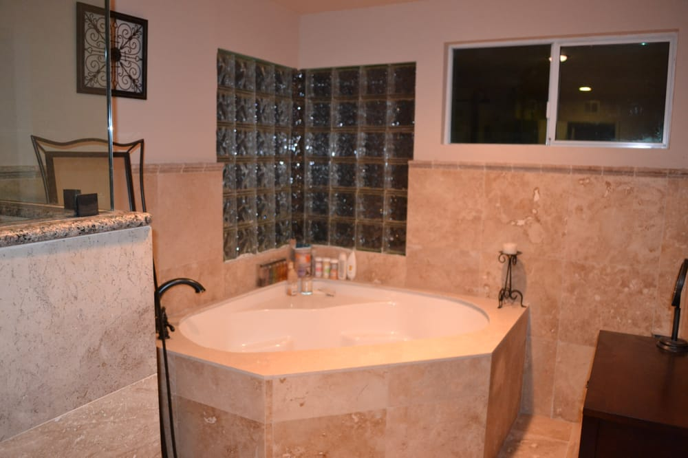 Conversion of drywall into glass block corner with jacuzzi tub ...