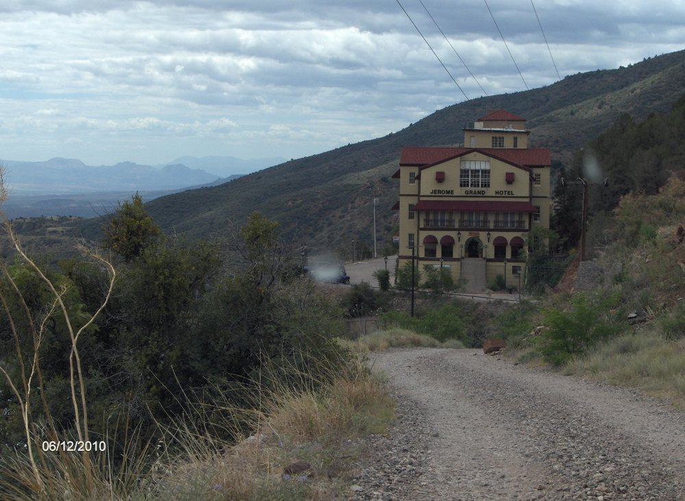 Photo of Asylum Restaurant - Jerome, AZ, United States. I took this pic of the Grand Hotel and the Asylum in 2010.  Notice the white auras?   Not on any of the other pictures I took. Just saying!