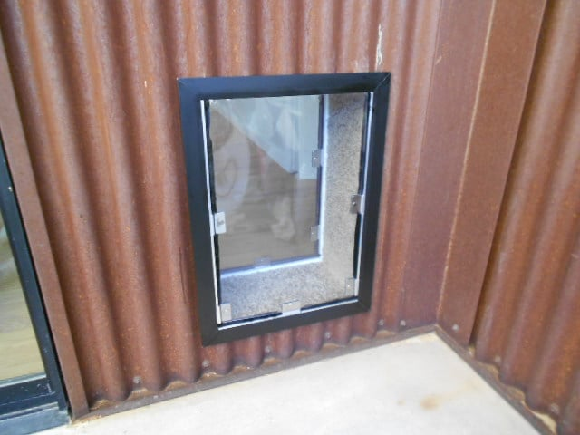 Photo of Affordable Pet Doors - La Jolla CA United States. Hale pet & Hale pet door installed into a corrugated metal exterior wall. - Yelp