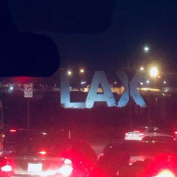 'Photo of Los Angeles International Airport - LAX - Los Angeles, CA, United States' from the web at 'https://s3-media1.fl.yelpcdn.com/bphoto/RAb85Yq_STzOc3bEgRrw5w/348s.jpg'