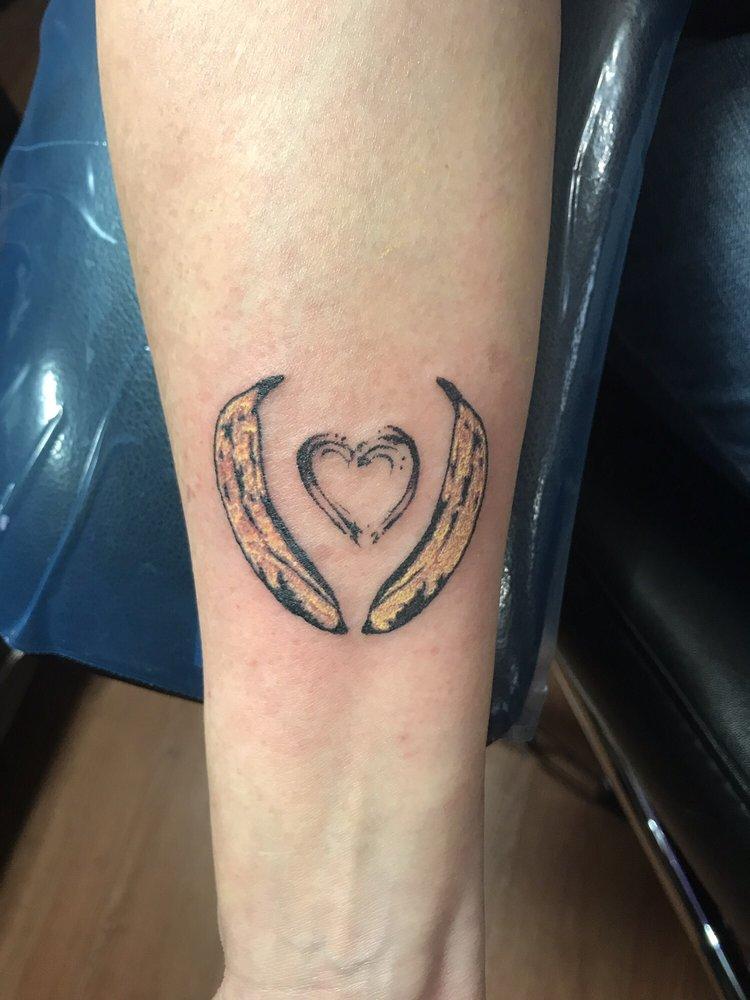 Slingers Tattoo: 140 W Main St, Monrovia, IN