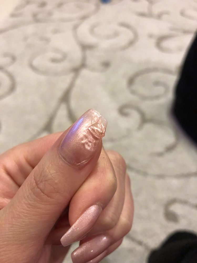 I got a fill with gel color and this happened after two hours - Yelp
