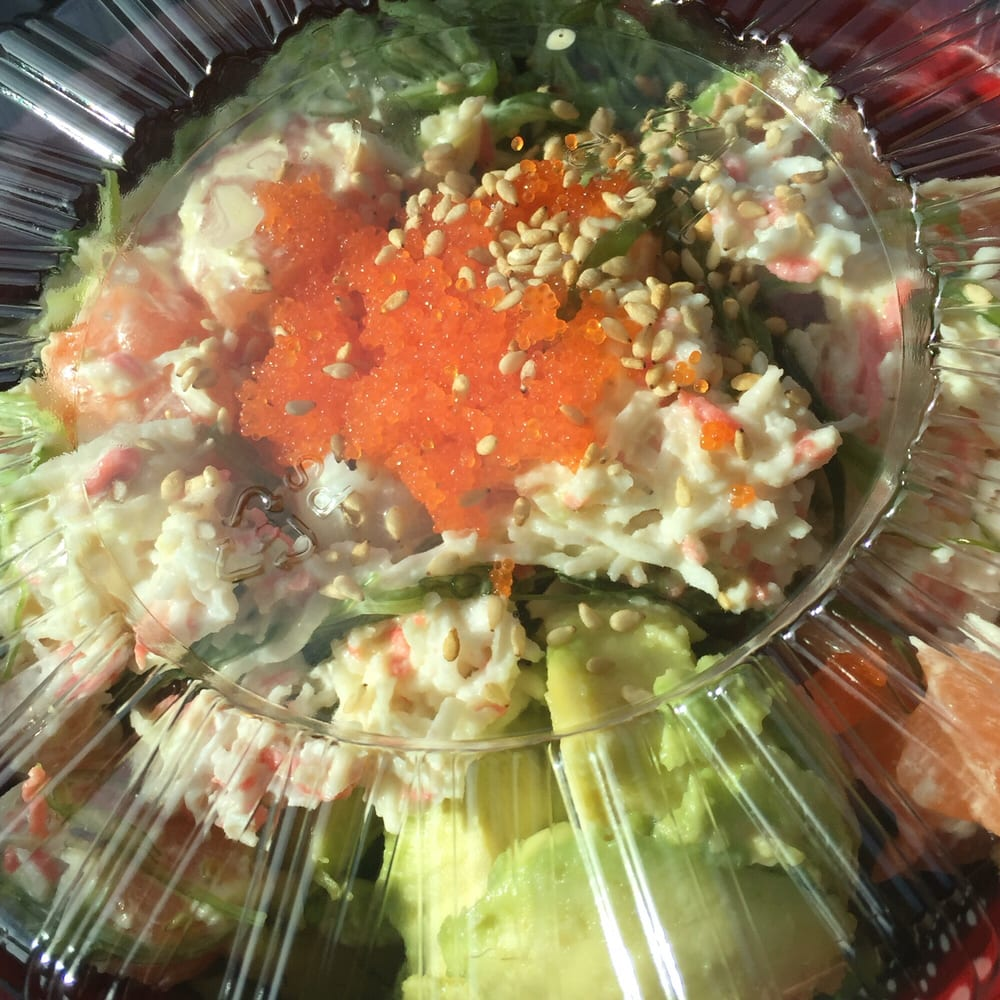 salmon, tuna, and scallop poke over brown rice with ...