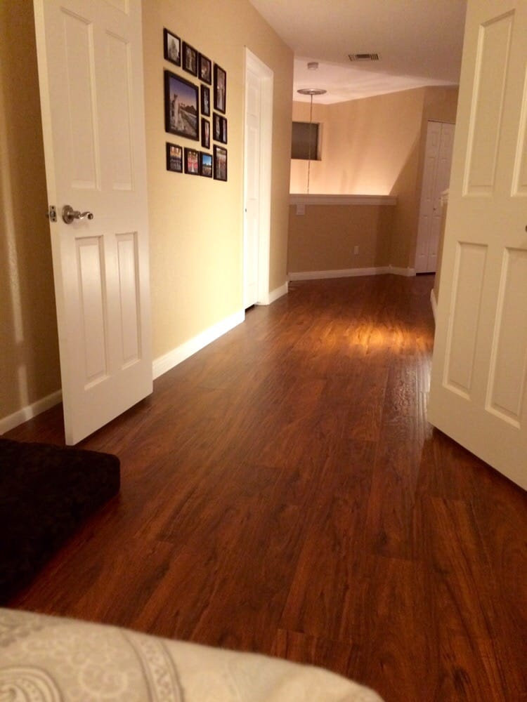 New brazilian cherry wood laminate in our upstairs bedroom for Wood flooring for bedrooms