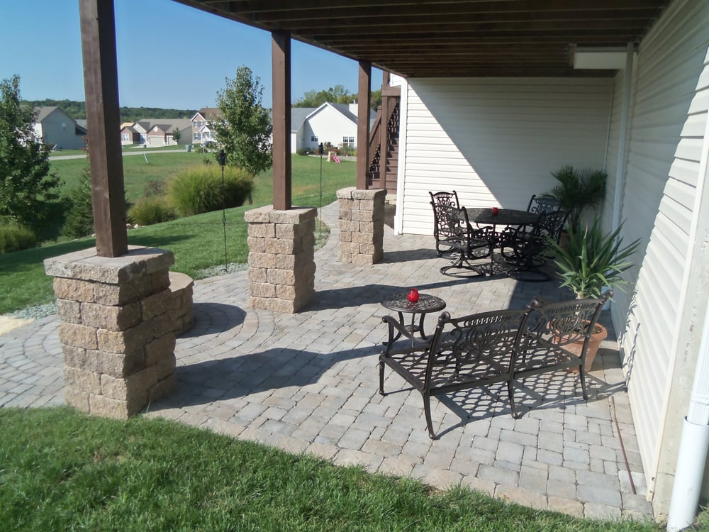 A Beautiful Paver Patio With Stone Columns Yelp