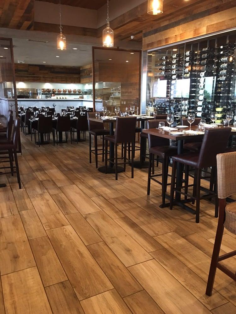 Photo of Spiga Cucina - Scottsdale AZ United States. Dining area and wine & Dining area and wine storage... - Yelp