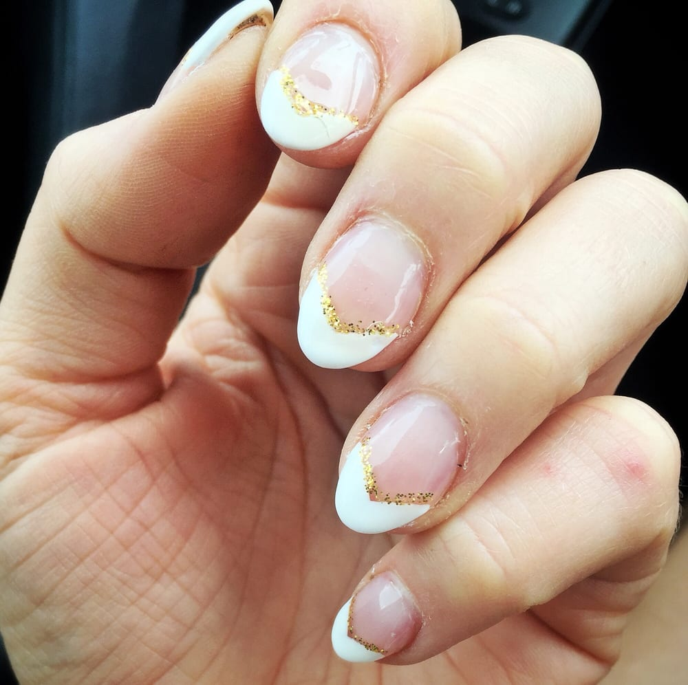 V-shaped French tip gel with gold glitter accent. Thanks Tommy!! - Yelp