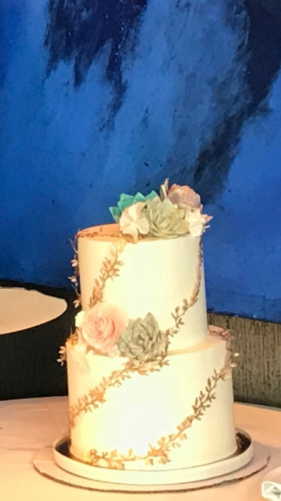 Wedding cake with succulent and gold garland - Yelp