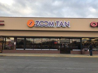 Zoom Tan - Olean: 1863 Plaza Dr, Olean, NY