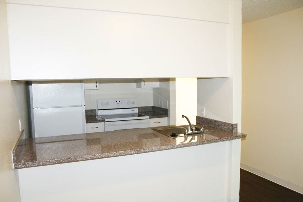 Semi Open Concept Kitchen Perfect For Hosting At Pine Square Apartments In Portland Or Templeton Property Management Nfn Investments Yelp