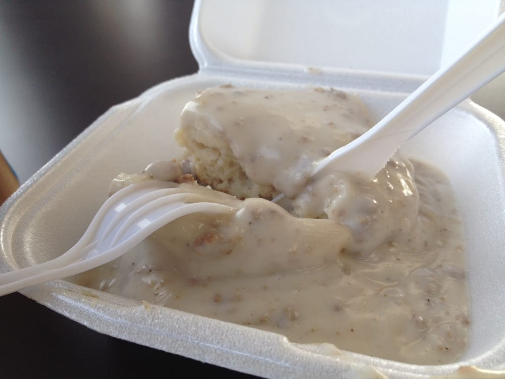 Digging into a fresh hot biscuit with gravy. Southern charm! - Yelp