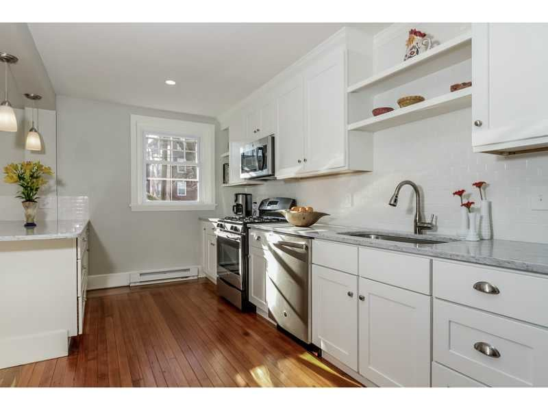 White Kitchen Cabinets White Appliances Subway Tile Backplash