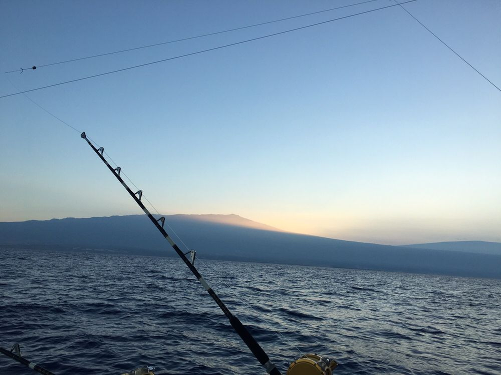 Beautiful sunrise while we were fishing yelp for Kona fishing charters