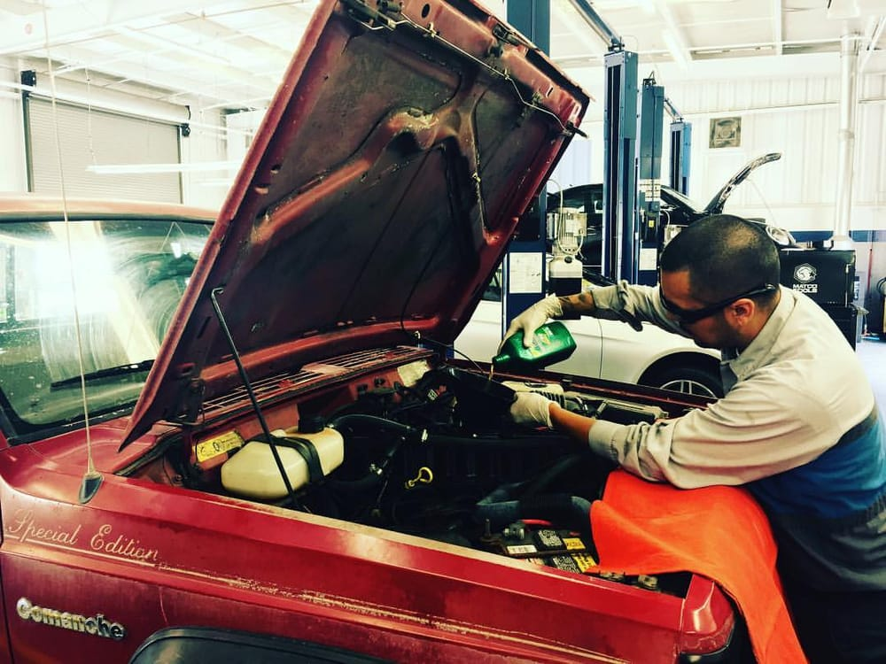 Our Certified Technician Working On A Classic 1988 Jeep