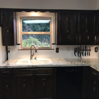 A recent kitchen remodel. New floors, fresh wall paint ...