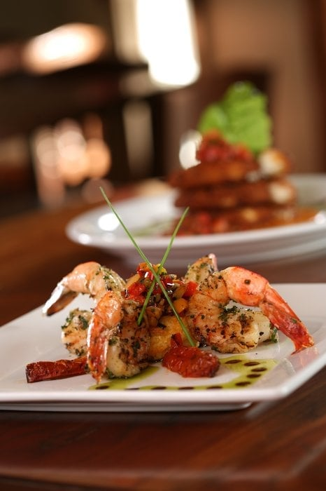 garlic basil marinated and grilled shrimp served with a goat cheese grit souffle and roasted. Black Bedroom Furniture Sets. Home Design Ideas
