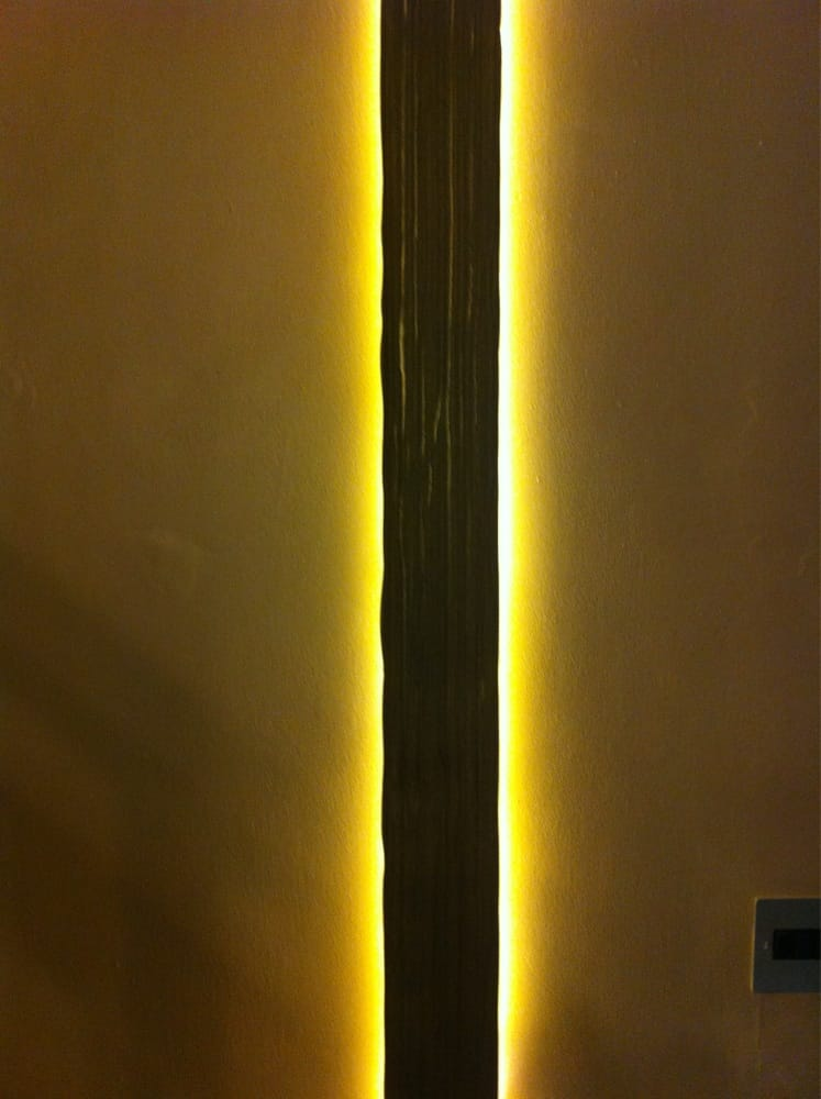 A simple piece of wall art using led strip wood and wall paper - Yelp