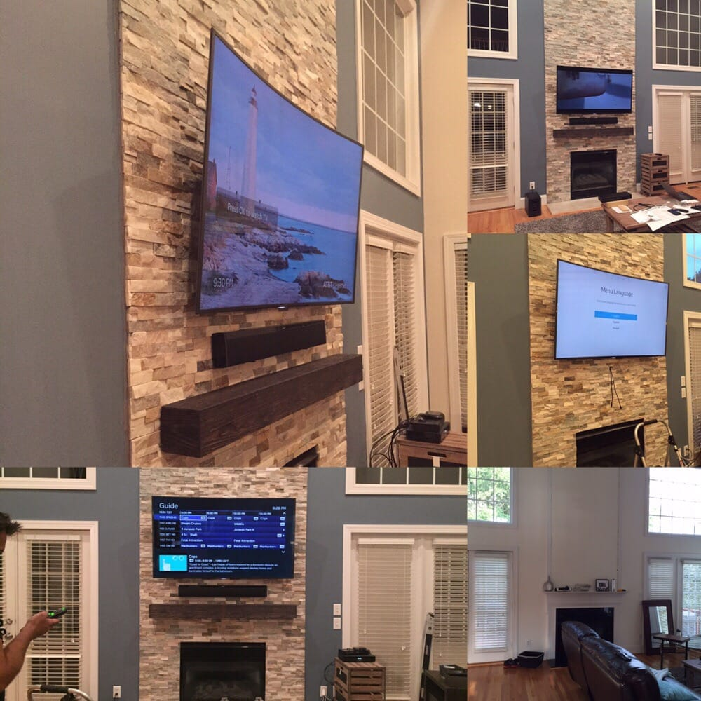 Curved TV mounted over fireplace TV sound bar and
