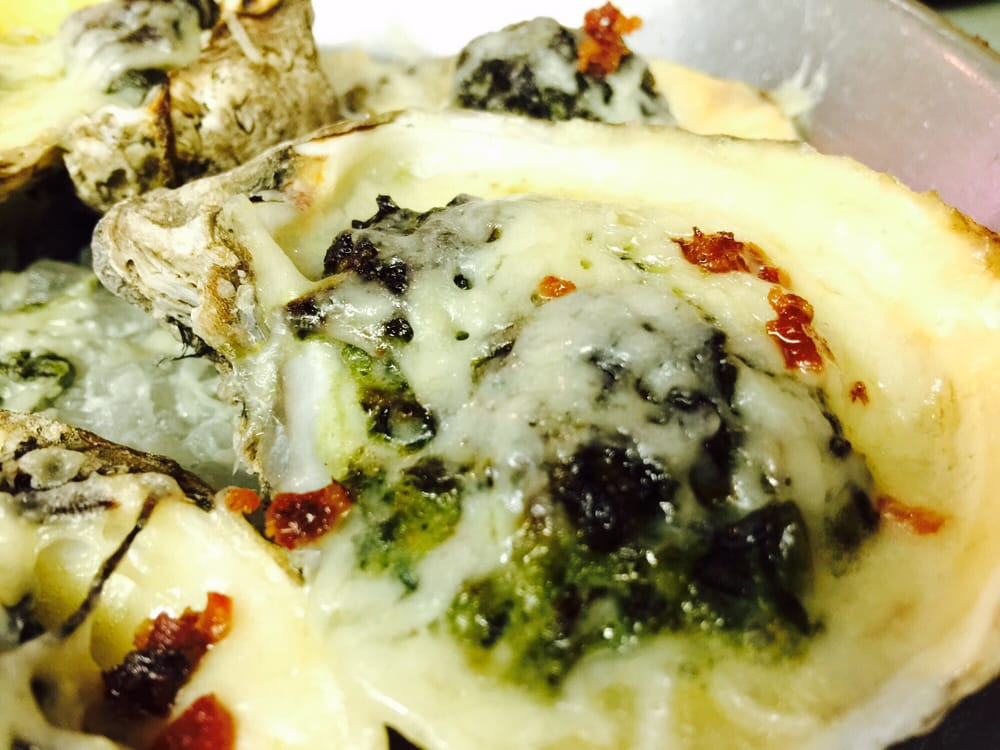Oysters Rockefeller with spinach, parma cheese & bacon nice
