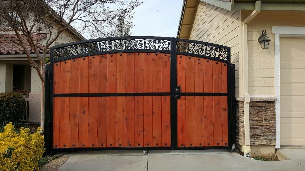Handmade custom iron arch driveway gate with decorative