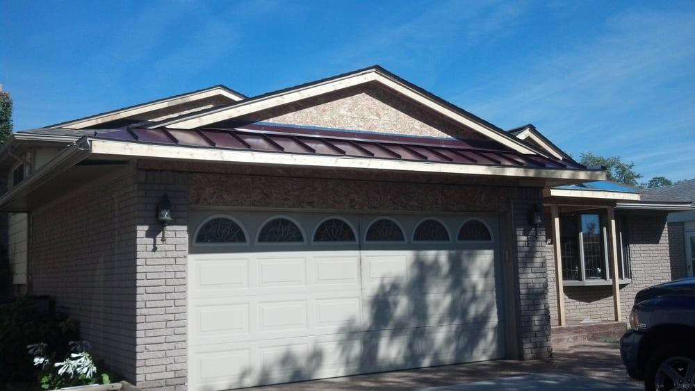 Standing Seam Metal Roof Accent Over Garage Door In