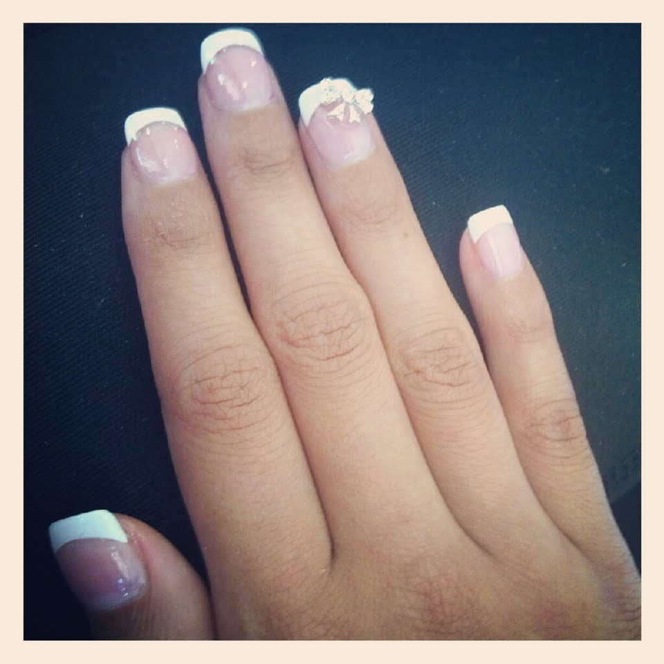 My acrylic french tip set & 3D bow. $32 - Yelp