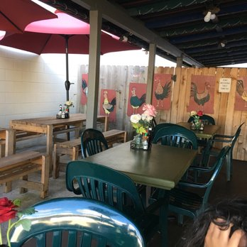 6993c822a Photo of Harley's Tropical Barbecue - Lihue, HI, United States. Seating  area outside