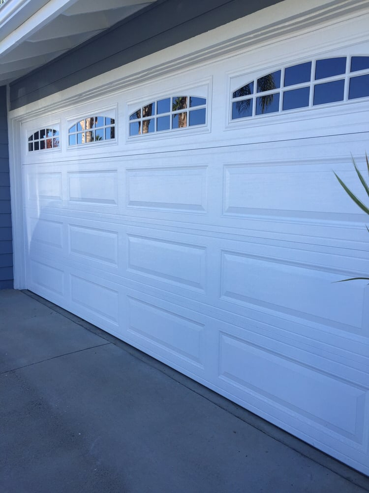 Install new 16 7 long panel with art stockton windows in for Local garage door