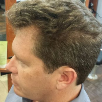 Mens hc has natural curly hair cut and Blowdry with Aveda be