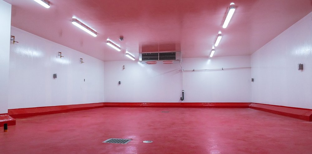 Food safe epoxy coating over all surfaces (walls, ceiling