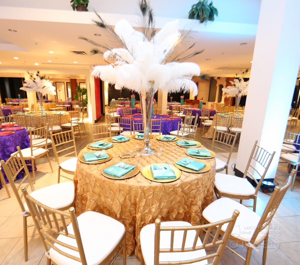 Ostrich And Peacock Feather Centerpiece For A Gold Aqua Purple And
