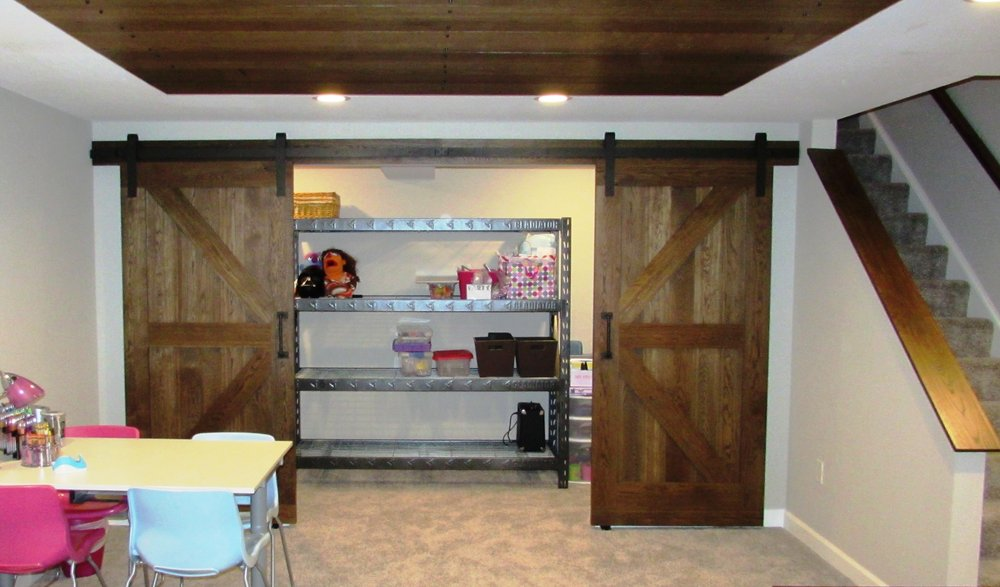 Open Barn Doors For The Storage Closet In This Ijamsville Basement Interesting Basement Remodeling Companies