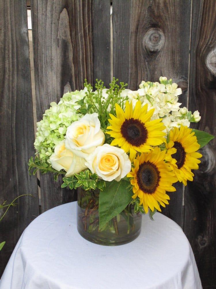 Sunflowers hydrangea roses hypericum centerpiece