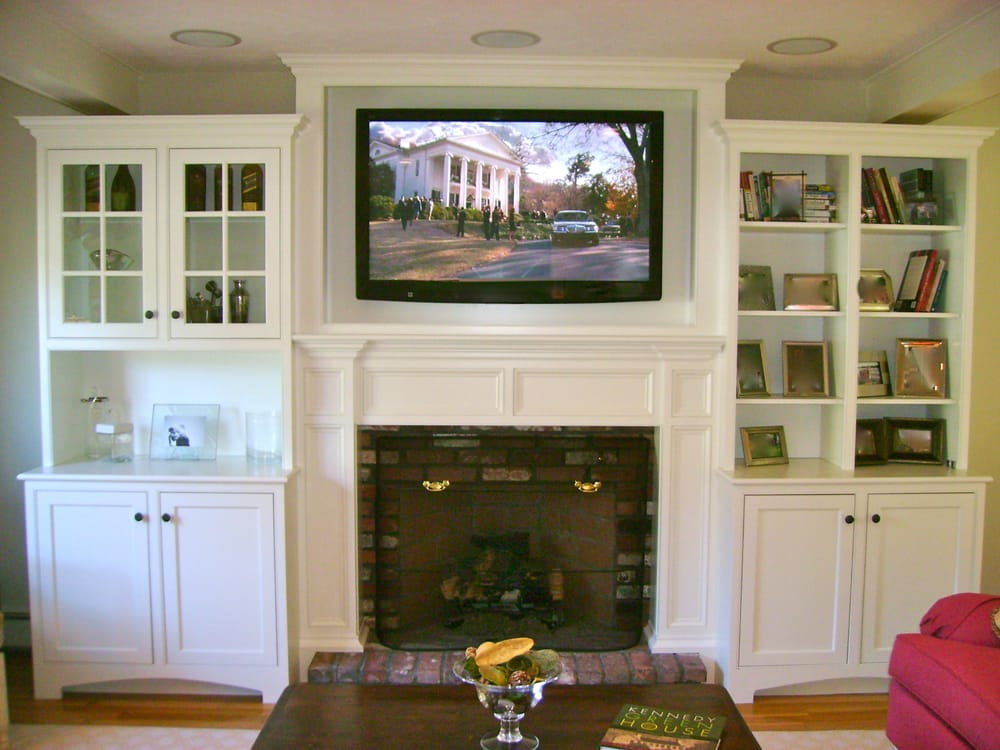 Tv mounted above fireplace in custom cabinet with in for Tv over fireplace