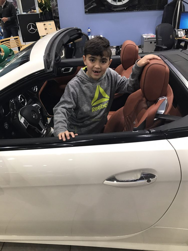 My son test driving the brand new benz yelp for Mercedes benz of littleton