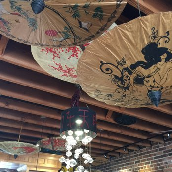 The Ceiling Is Covered With These Beautiful Umbrellas And
