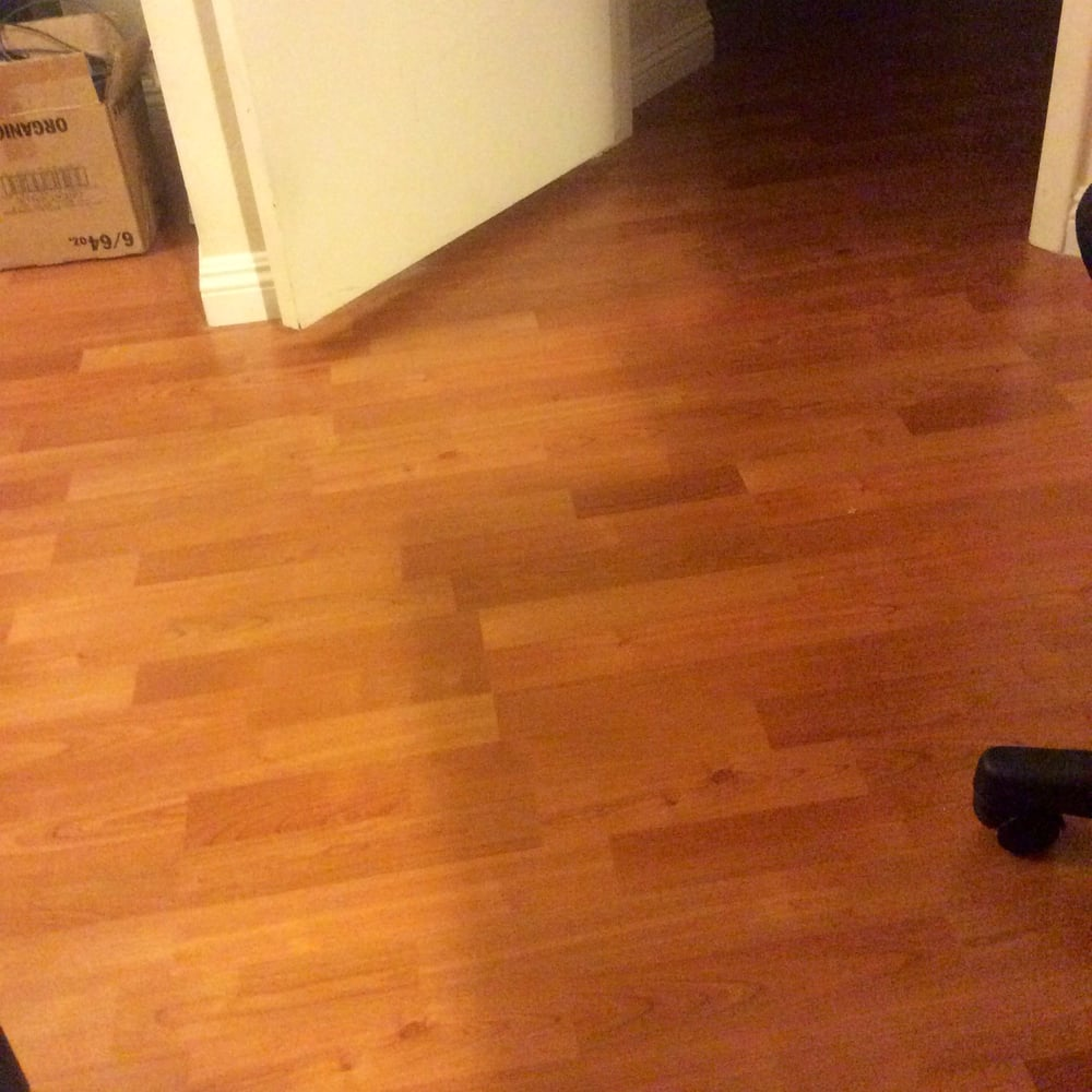Wood Laminate Flooring With Four 4 Inch Baseboards
