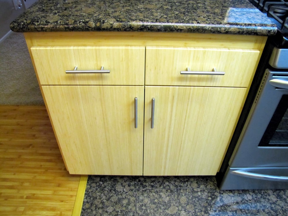 These oak kitchen cabinets were refaced using solid bamboo for Bamboo kitchen cabinets reviews