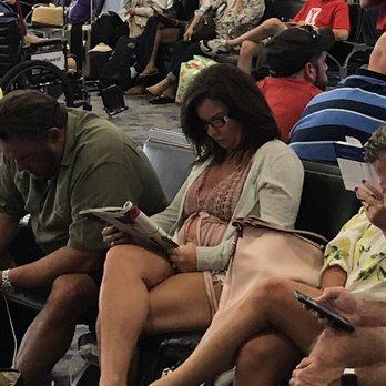 'Photo of McCarran International Airport - Las Vegas, NV, United States. I guess the casino stopped short of stealing the shirt off her back.' from the web at 'https://s3-media1.fl.yelpcdn.com/bphoto/Z0YG9LVCAeqDi6jWkfP7Dg/348s.jpg'