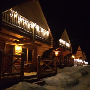 Photo Of Pocahontas Cabins   Jasper, AB, Canada. Cabins Lit With Festive  Lights