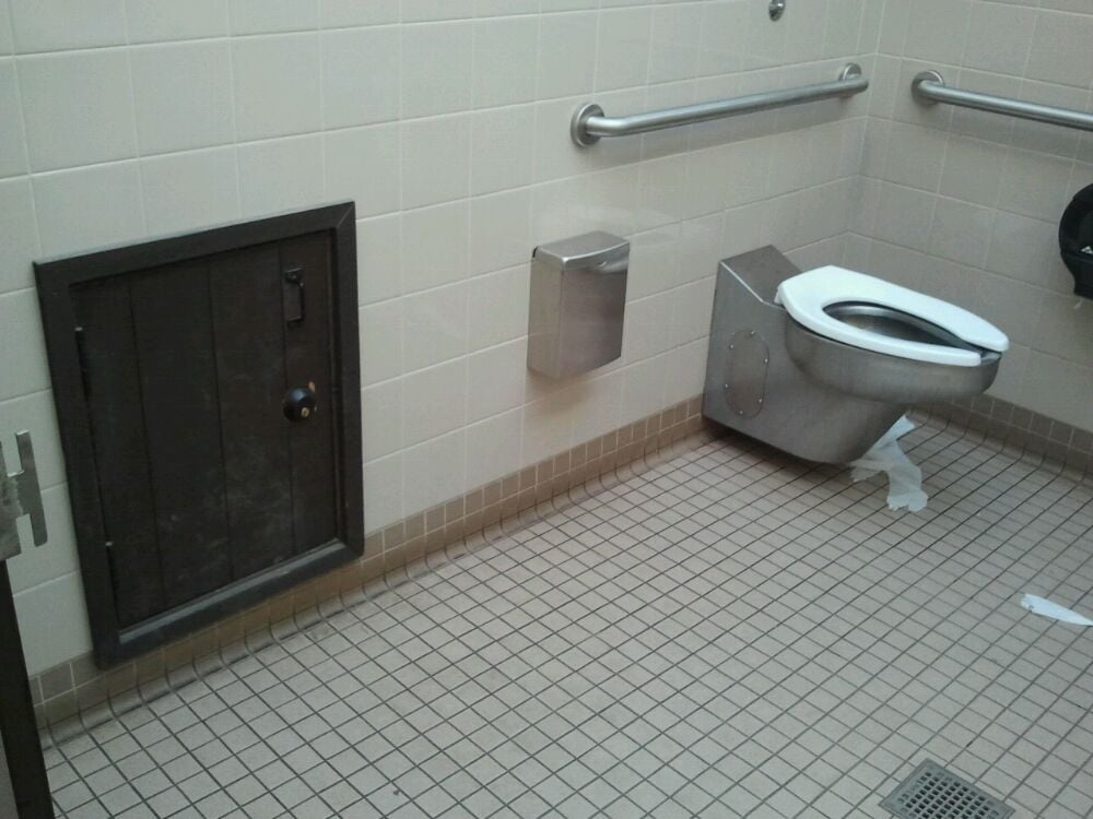 Little door in the womens bathroom stall watch out for - Bathroom partition installers near me ...
