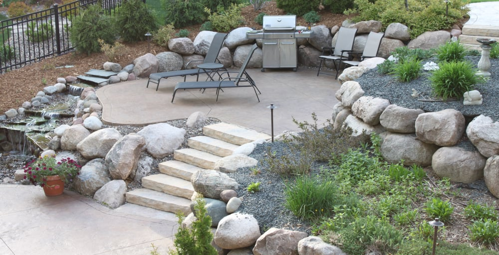 Two Tiered Stamped Amp Colored Patio With Boulder Retaining