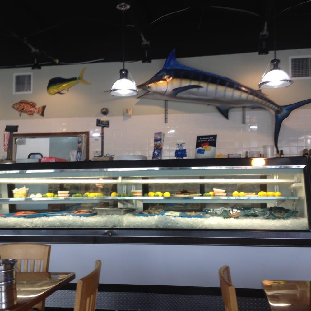 Fresh seafood display case yelp for Fresh fish market miami