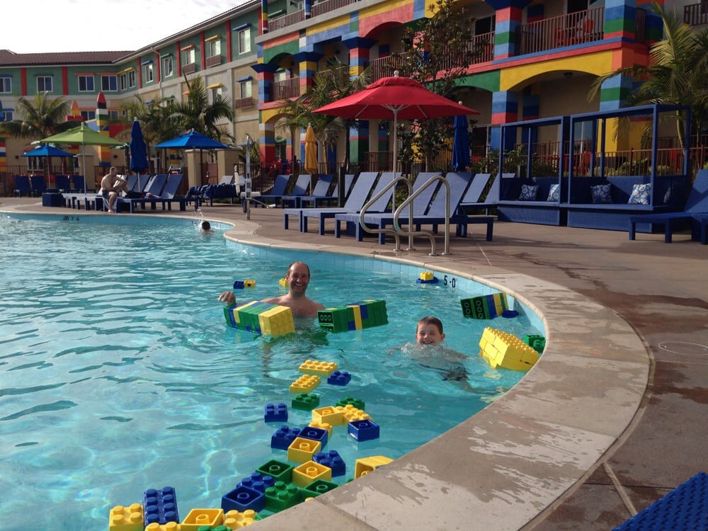Swimming at the pool full of floating oversized legos yelp for Hotels near legoland with swimming pool