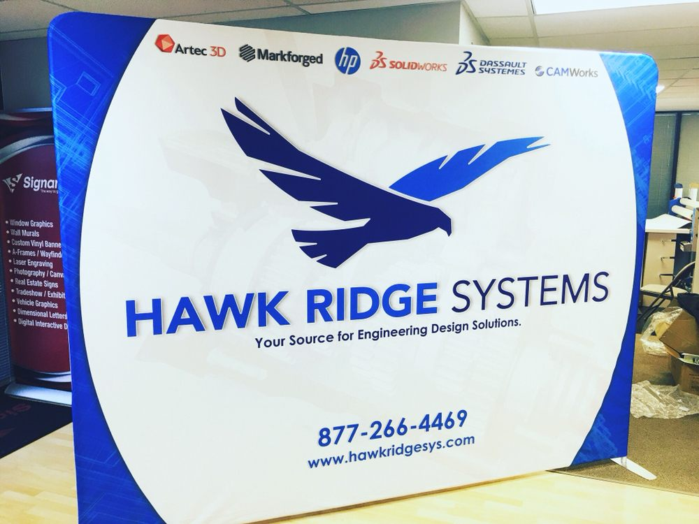 Hybrid sign solutions with laser-cut acrylics, vinyl wrap on brushed