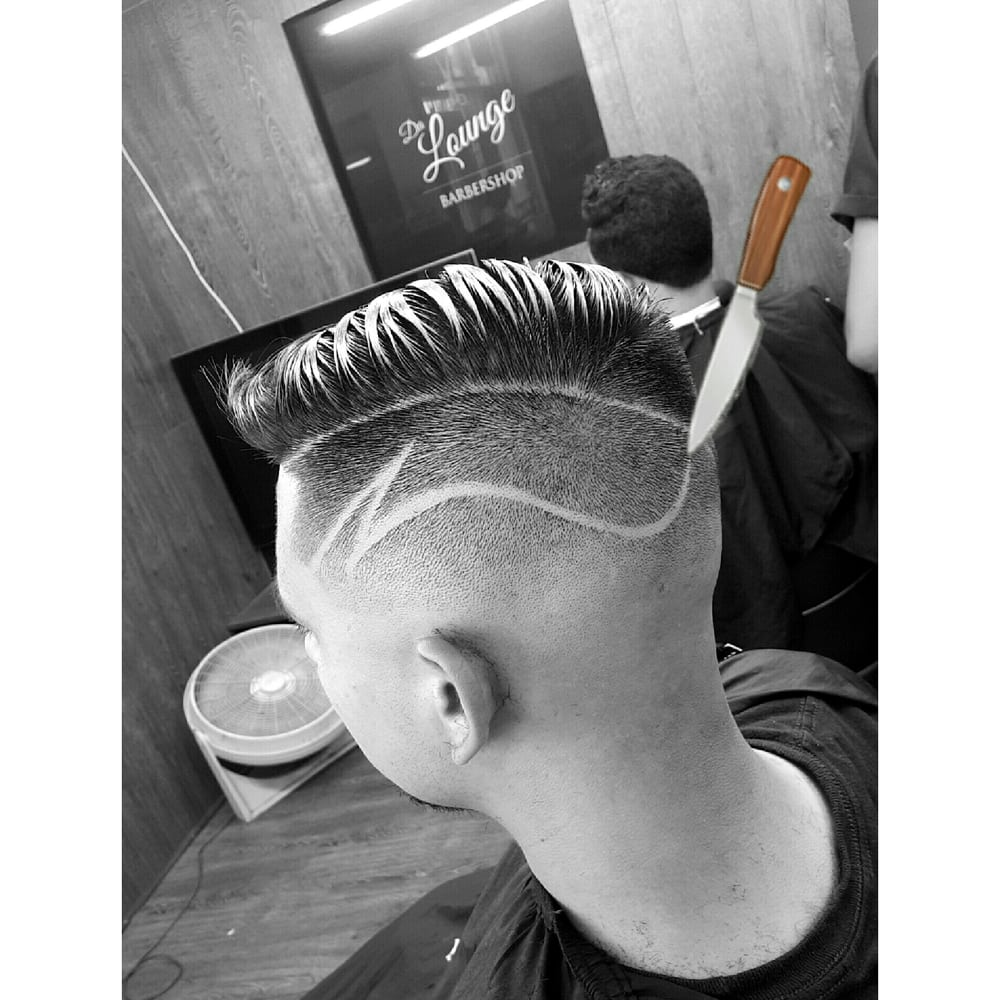 Soft as butter mid skin fade with creative freestyle part haircut photo of da lounge barbershop los angeles ca united states soft as urmus Image collections