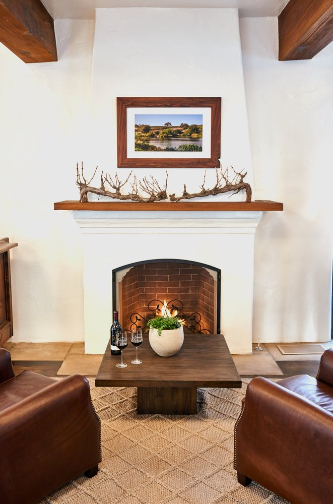 Sink Back Into The Leather Chairs In Front Of The Fireplace In Our